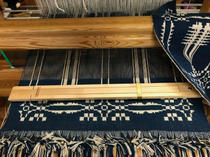 In work on the loom
